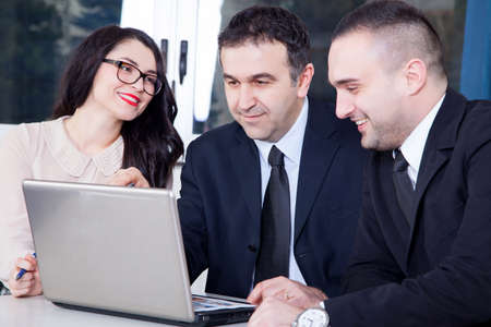 unanimous: A business team of four plan work in office Stock Photo