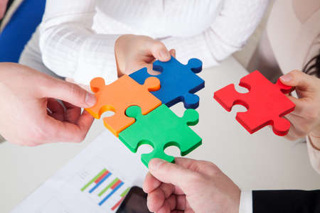 support group: Cooperation concept of the strategic solution by puzzles Stock Photo
