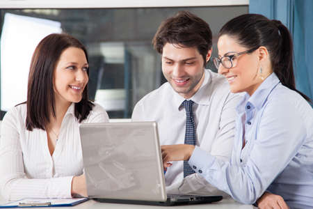 A business team of four plan work in office Standard-Bild