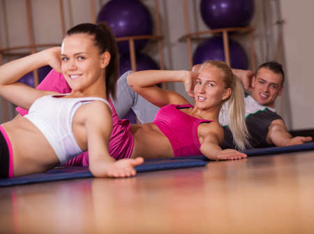 stretching pilate exercises in fitness studio