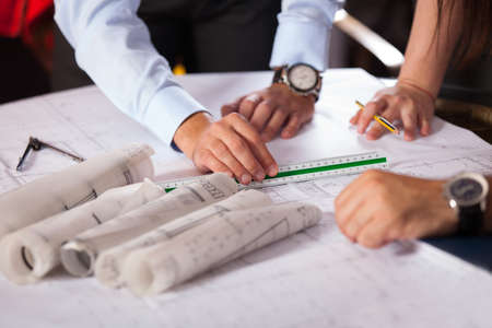 Team of architects working on construction plans Stock Photo