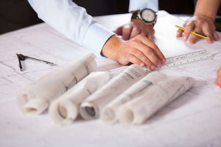 architect plans: Team of architects working on construction plans Stock Photo