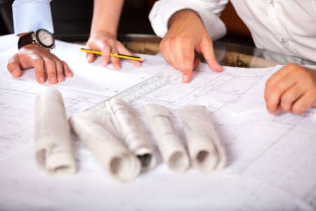 Team of architects working on construction plans Stockfoto