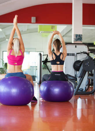women working out: beautiful young women working out in the fitness studio
