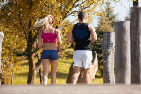 fitness, sport, friendship and lifestyle concept - smiling couple  running outdoors Stock fotó - 37470405