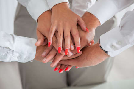 joining hands: Team work concept. Business people joining hands.