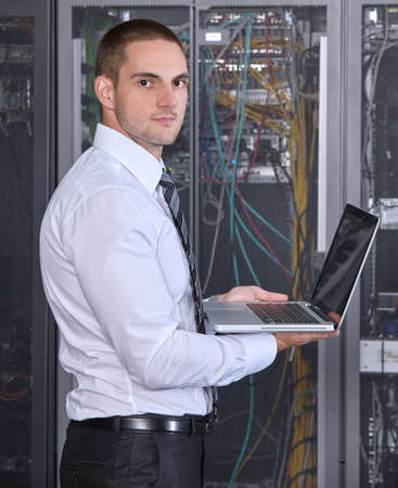 isp: business man engeneer in modern datacenter server room