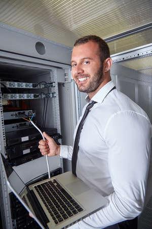 web security: business man engeneer in modern datacenter server room