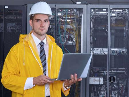 business service: business man engeneer in modern datacenter server room