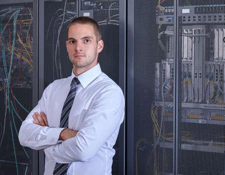 business man engeneer in modern datacenter server room