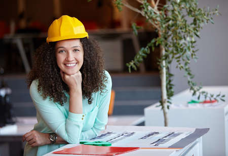 Young female architect in office