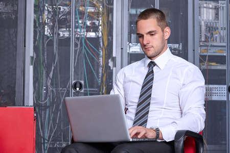 server room: business man engeneer in modern datacenter server room