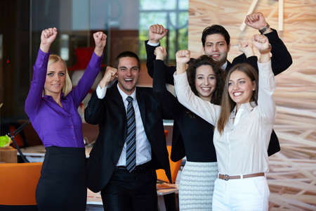 teamwork people: Business team celebrating a triumph in office with arms up