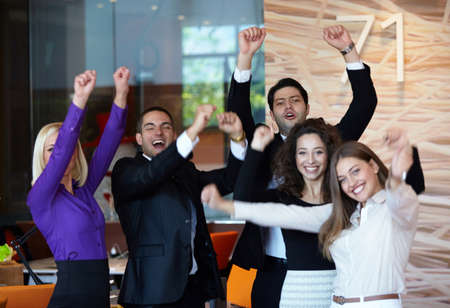 arms up: Business team celebrating a triumph in office with arms up