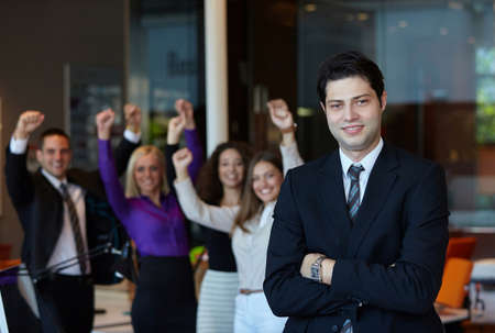 confident business woman: Successful businessman at the office