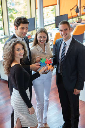 men ideas: Group of business people assembling jigsaw puzzle and represent team support
