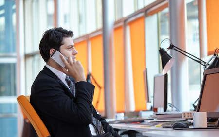 businessman using smartphone and computer Standard-Bild