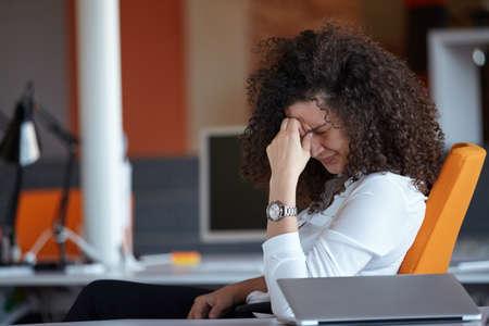 woman in the office having a headache