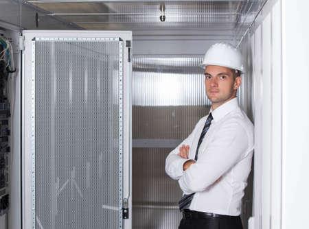 isp: network engineer working in server room