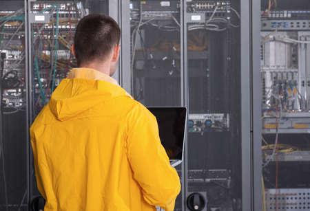 centro de computo: it engeneer businessman with thin modern aluminium laptop in network server room
