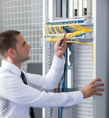 database server: network engineer working in server room