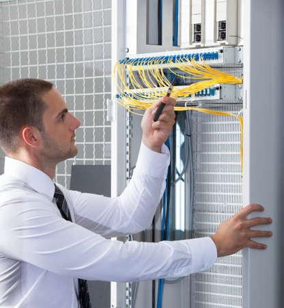 network server: network engineer working in server room
