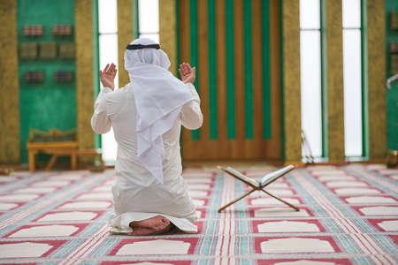 Religious muslim man praying inside the mosque Stock Photo