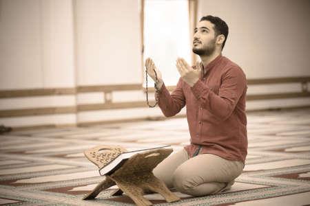 Religious muslim man praying inside the mosque 写真素材