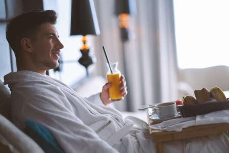 Breakfast in bed, cozy hotel room. concept Stock Photo