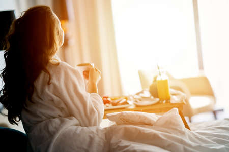 Breakfast in bed, cozy hotel room. concept Stockfoto