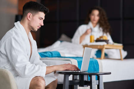 Couple relaxing and working from hotel room. concept 스톡 콘텐츠