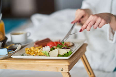 Breakfast in bed, cozy hotel room. concept Standard-Bild