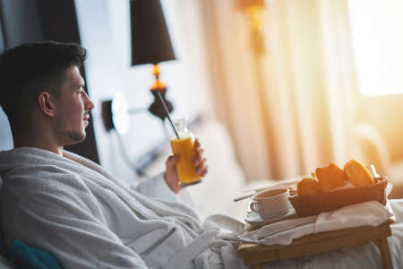 Breakfast in bed, cozy hotel room. concept Stock Photo