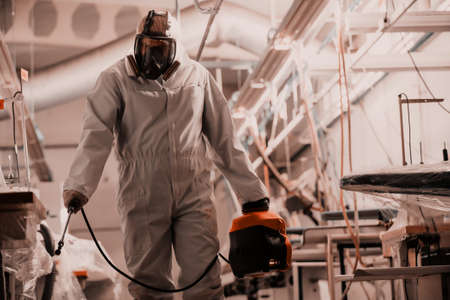 Coronavirus Quarantine. Disinfection and decontamination on a public place and factory as a prevention against Coronavirus disease 2019, COVID-19. State of emergency over pandemia with coronavirus. Foto de archivo