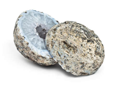 Crystal geode divided in two parts  with white quartz crystals inside isolated