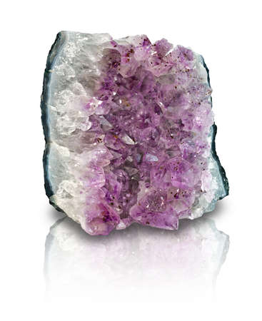 Slab of amethyst geode on white background with reflection. Amethyst is a protective and spiritual stone that is used to open your awareness of your higher self. Фото со стока - 10786735