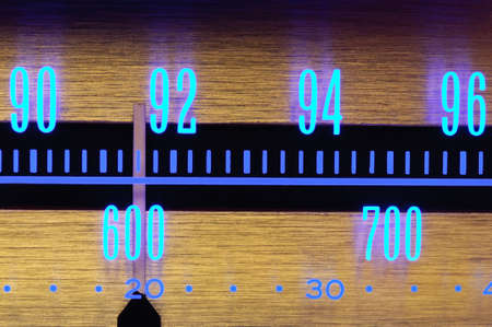 70�s Old radio dial close-up with glowing scale numbers