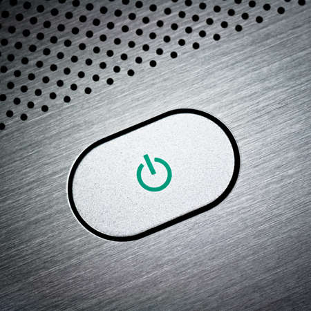 Silver laptop power button close-up Stock Photo - 10786741