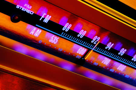 Analog radio tuner FMAM closeup with colorful psychedelic lighting