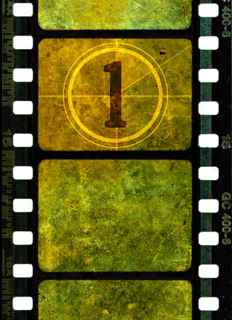 Vintage 35 mm film reel, colorful grunge textured film frames and a number one in countdown