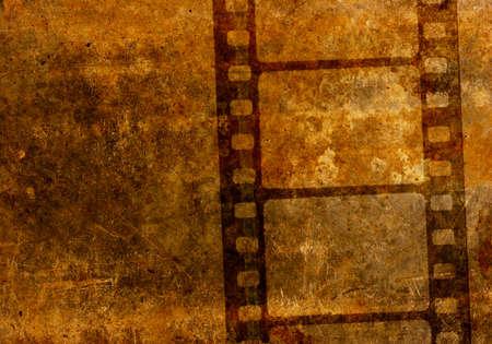 cine: Vintage 35 mm film reel stencil over rusted grunge textured background