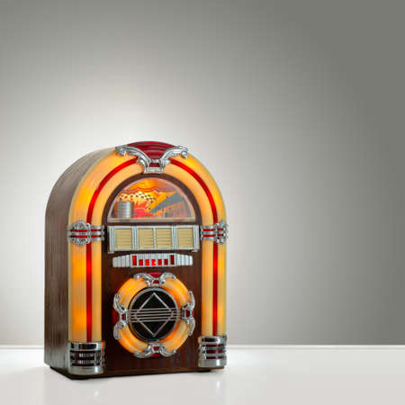 hits: Old retro jukebox in an empty room with nice illumination, copy space ready