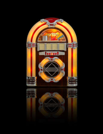 hits: Retro jukebox radio isolated on black background with reflection