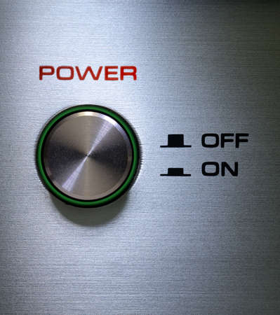 Antique power button with a ligting green border photo