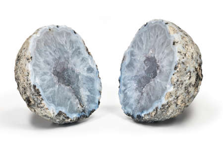 rock formation: Crystal geode  with white quartz crystals inside divided in two parts isolated