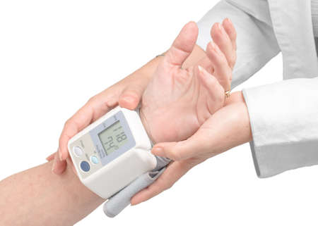 preventive medicine: Doctor measuring the pressure in an elderly patient with a blood pressure digital monitor.  Stock Photo