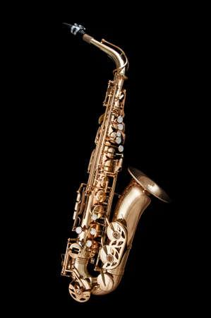 shiny black: Alto Saxophone woodwind instrument isolated over black background