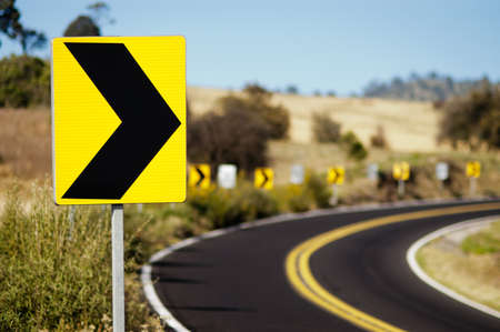 curve: Turn right signal on country road Stock Photo