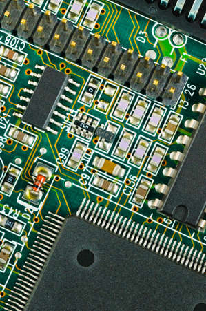 PCB  Closeup of green electronic circuit board and components