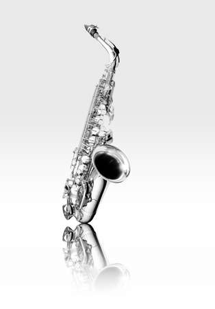 Alto saxophone woodwind instrument black and white isolated with reflection photo